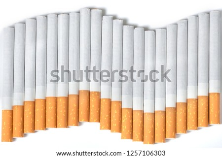 Cigarettes in the form of a wave at the white background. A view from above #1257106303