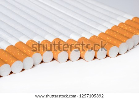 Cigarettes in the perspective at the white background #1257105892