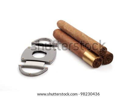 Cigars and a open cutter isolated on white background
