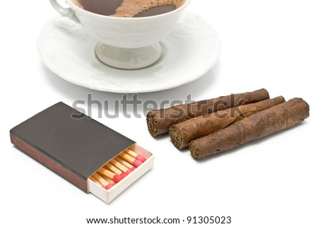 Cigars with matches and cup of coffee on white - stock photo