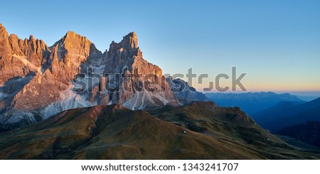 Cimon della Pala and Vezzana peaks, Pale di San Martino, Dolomites, at sunset.