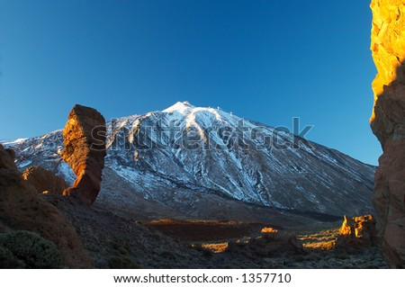 Cinchado rock of Los Roques de Garcia and Teide volcano at sunset (Tenerife)