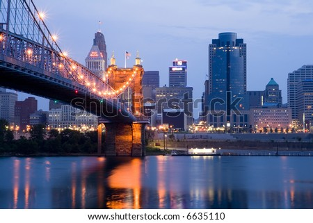 Cincinnati skyline and Roebling Suspension Bridge shortly before sunrise. (Editorial version) - stock photo