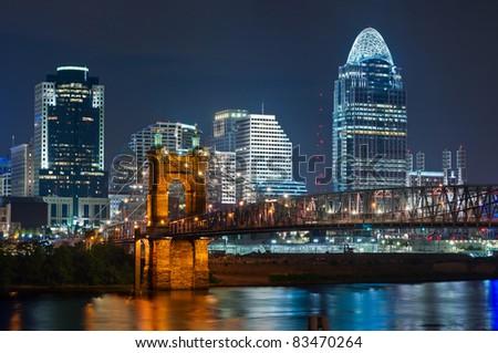Cincinnati skyline. Image of Cincinnati and John A. Roebling suspension bridge at night. - stock photo