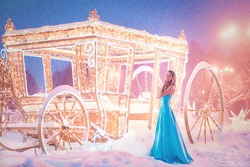 Cinderella near carriage going to dance. Anticipation. Snowy weather