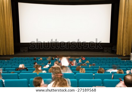 Cinema auditorium with people waiting in green chairs on movie performance. Ready for adding your own picture.