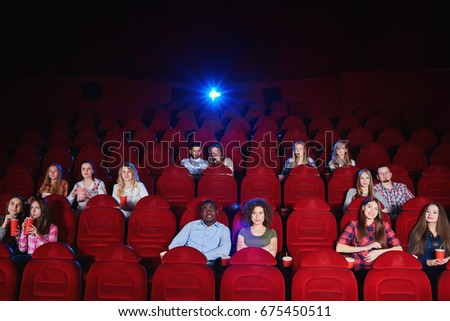Cinema auditorium with spectators sitting watching a movie copyspace enjoyment recreation entertainment holidays weekend premiere films comedies activity concept.