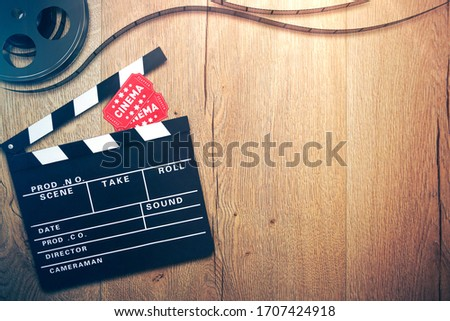 Cinema background with clapperboard, tickets and film reel