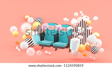 Stock Photo Cinema chair Soft drinks and popcorn among the colorful balls on the pink background.-3d rendering.