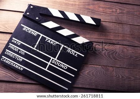 Photo of  Cinema, clapboard, director.