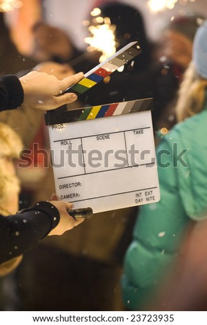 Cinema clapper against the background with many people