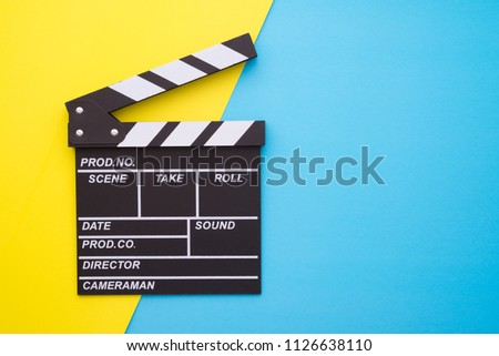 Cinema clapperboard on yellow blue colorful background - Movie cinema entertainment concept