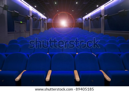 cinema or theatre empty seats with projecton light