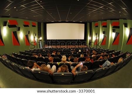 Cinema red seats in cinema hall 3 - stock photo