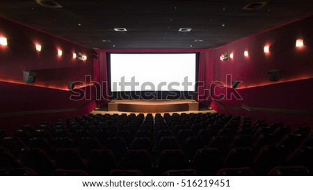 Cinema screen with open curtain and red seats - 3d
