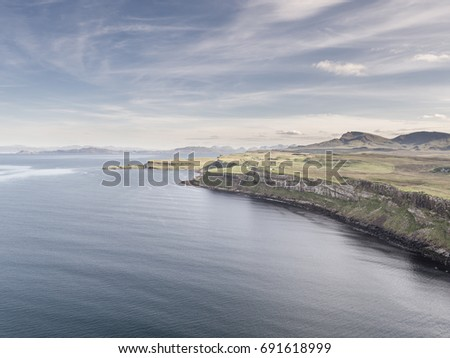Cinematic aerial shot of the dramatic coastline at the cliffs close to the famous Kilt Rock waterfall ,Skye - Scotland