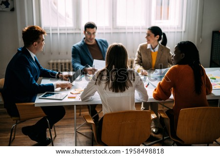 Cinematic image of   employers working in a start up business. Young people at work in a modern office Сток-фото ©