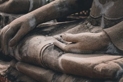 Cinematic photo of buddha statue hand in meditation pose to show the concept of harmony between mind and body, mindfulness and wellness