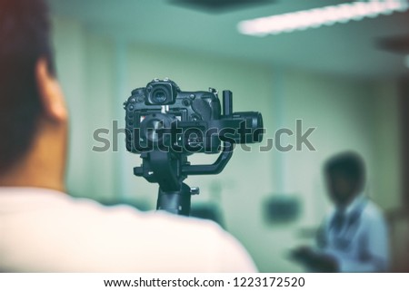 Cinematographer shoots use dslr camera and gimbal stabilizer movement. This is photographer freelance or Vlogger creat content.