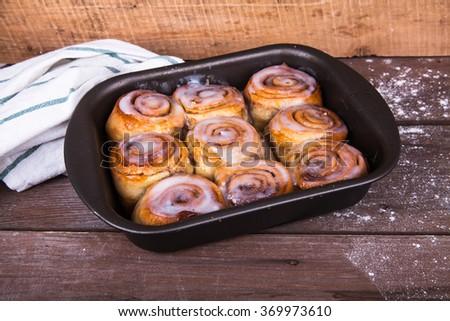 Cinnabon on a wooden background #369973610