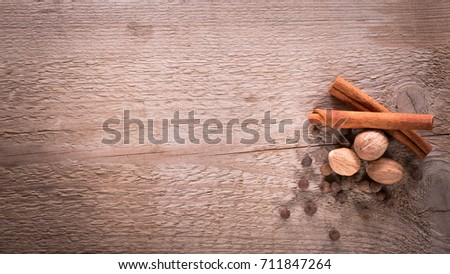 Cinnamon, allspice and nutmeg. Spices on wooden background. Natural and bio ingredients for cooking. Top view and copy space for your text. #711847264