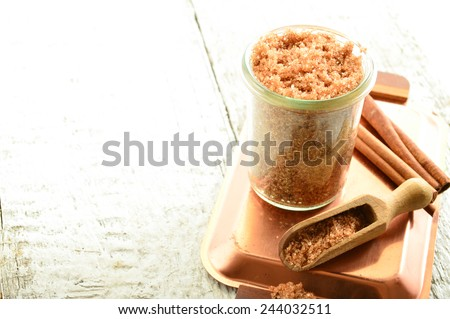 Cinnamon body scrub on a white background