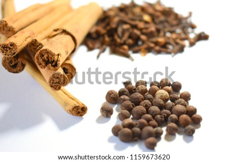 Cinnamon, Cloves and Allspice on White Background #1159673620