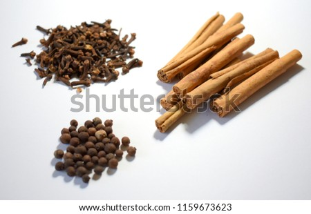 Cinnamon, Cloves and Allspice on White Background #1159673623