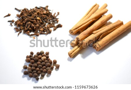 Cinnamon, Cloves and Allspice on White Background #1159673626