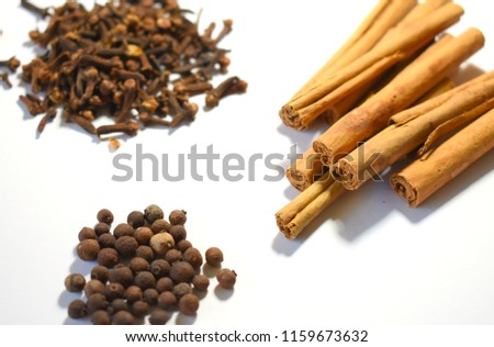 Cinnamon, Cloves and Allspice on White Background #1159673632