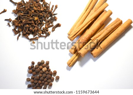 Cinnamon, Cloves and Allspice on White Background #1159673644