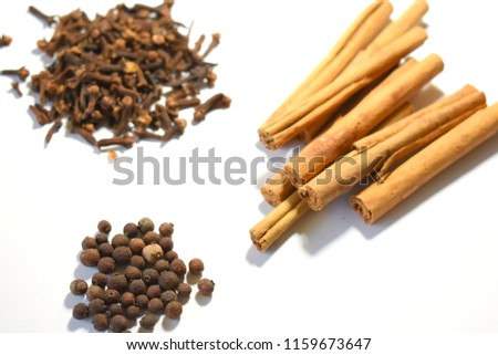 Cinnamon, Cloves and Allspice on White Background #1159673647