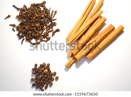 Cinnamon, Cloves and Allspice on White Background #1159673650