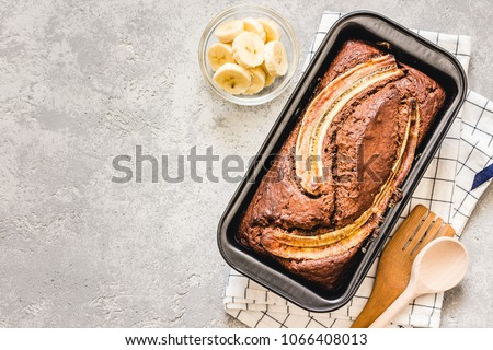 Cinnamon crunch banana bread on light concrete background. Selective focus, space for text.