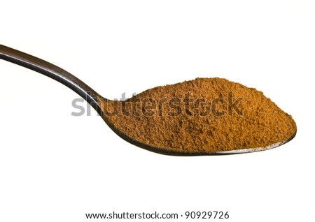 Cinnamon in a spoon isolated over white background