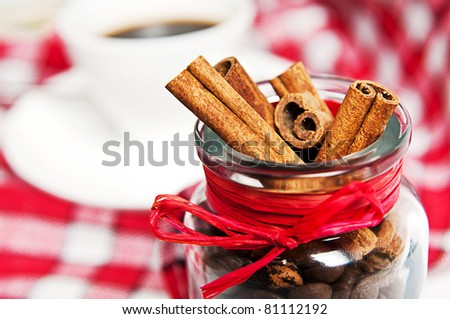 cinnamon  in the pot on a red tablecloth