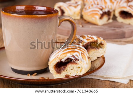 Cinnamon pecan danish and cup of coffee on a pate #761348665