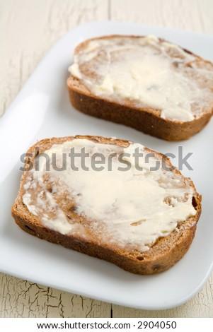 cinnamon raisin toast with butter spread on the slices