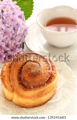 Cinnamon roll with English tea on background for gourmet breakfast image