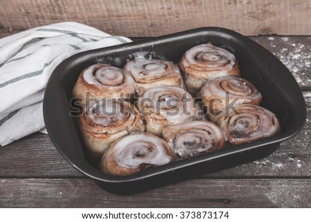 cinnamon rolls on a wooden background #373873174
