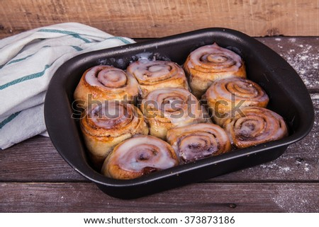 cinnamon rolls on a wooden background #373873186