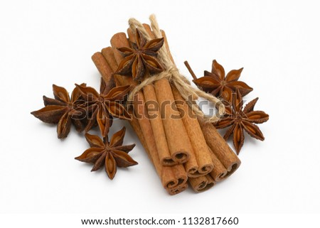 Cinnamon sticks and cardamom on a white background. Aromatic spices. #1132817660