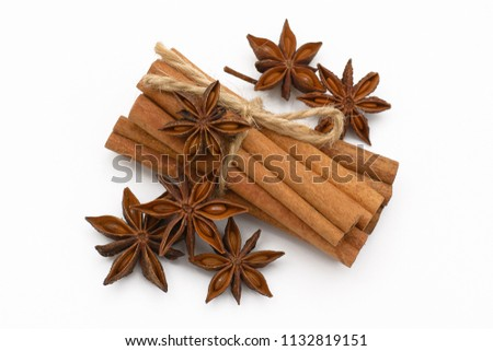 Cinnamon sticks and cardamom on a white background. Aromatic spices. #1132819151