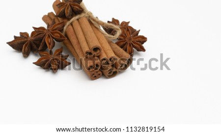 Cinnamon sticks and cardamom on a white background. Aromatic spices. #1132819154
