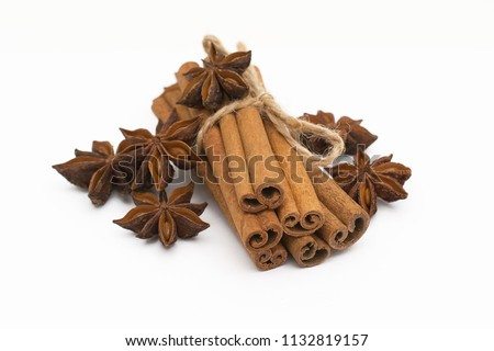Cinnamon sticks and cardamom on a white background. Aromatic spices. #1132819157