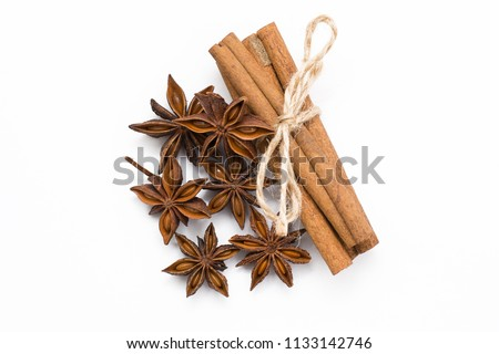 Cinnamon sticks and cardamom on a white background. Aromatic spices. #1133142746