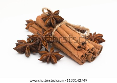 Cinnamon sticks and cardamom on a white background. Aromatic spices. #1133142749