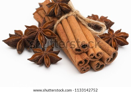 Cinnamon sticks and cardamom on a white background. Aromatic spices. #1133142752