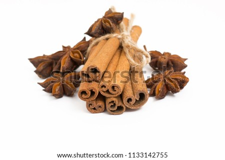 Cinnamon sticks and cardamom on a white background. Aromatic spices. #1133142755