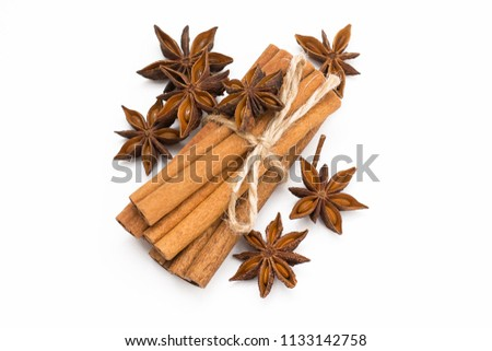 Cinnamon sticks and cardamom on a white background. Aromatic spices. #1133142758